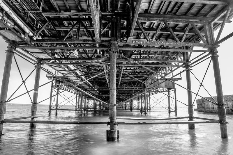 Under the Pier Architecture Built Structure Water Underneath Bridge Connection No People Metal Bridge - Man Made Structure Architectural Column Day Sea Below Nature Outdoors Low Angle View Beach Girder Pier Palace Pier Brighton