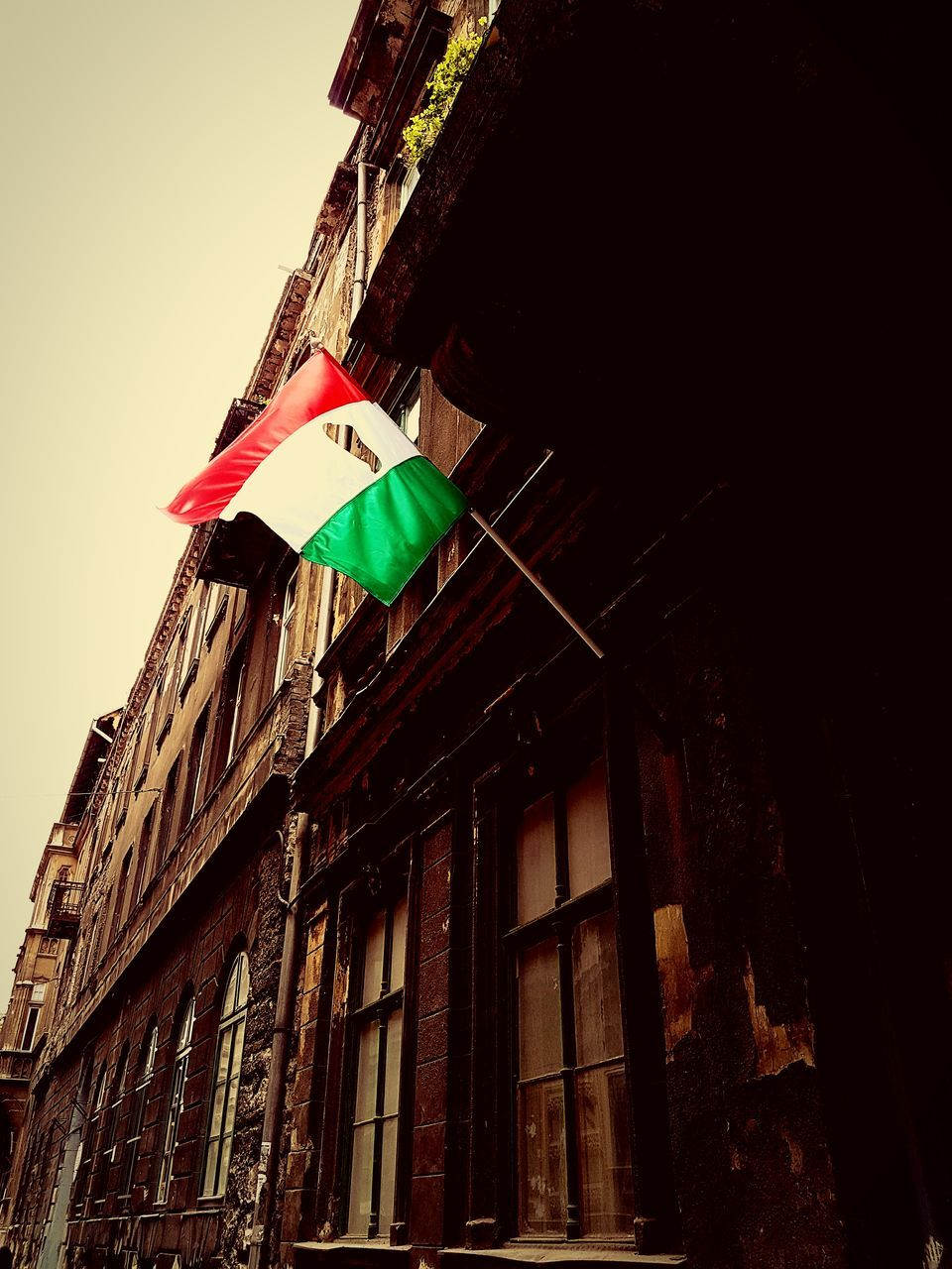 architecture, low angle view, built structure, flag, building exterior, no people, day, outdoors