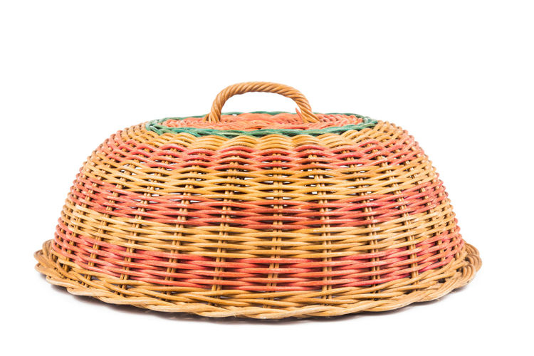 Traditional handmade rattan woven food cover from Malaysia Beautiful Rattan Wicker Food Cover Handicraft Handmade Isolated White Background Malaysia Still Life Studio Shot Tranditional