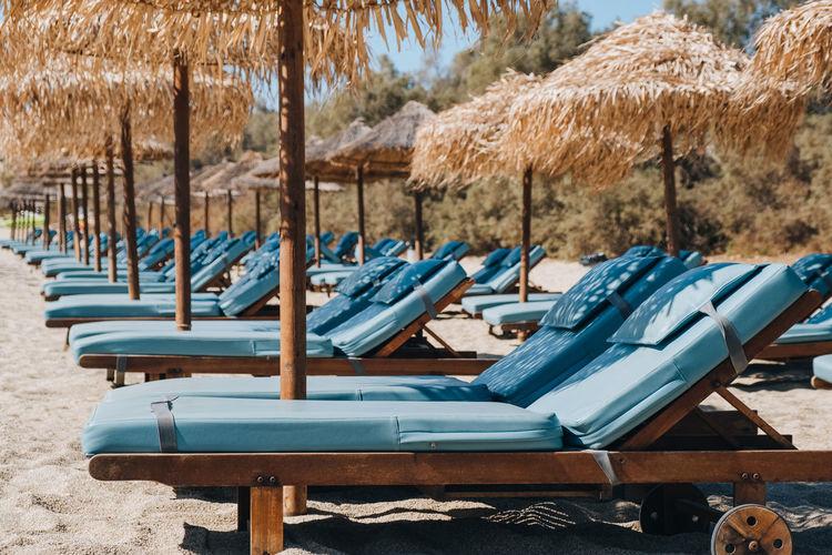 Empty chairs on beach
