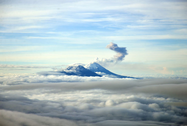 Scenic View Of Volcanoes Amidst Cloudscape
