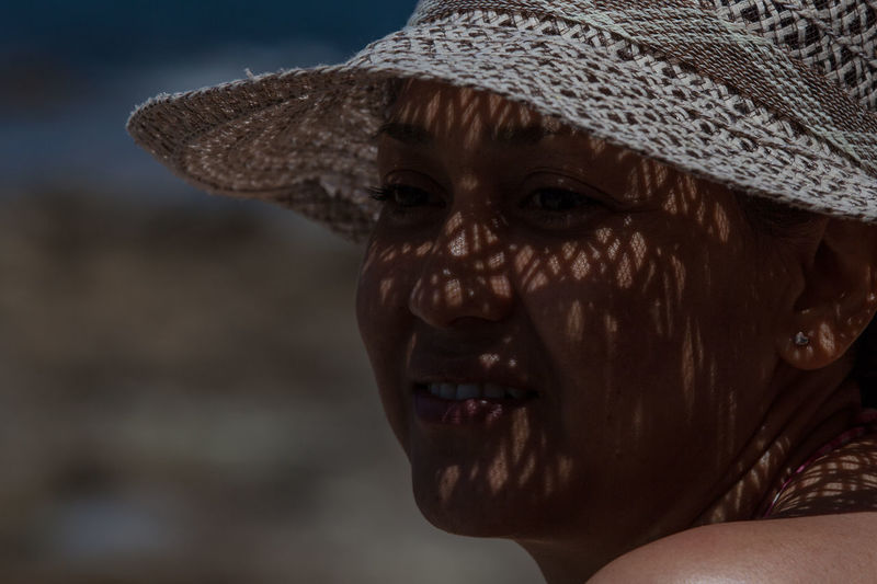 Beach Life Beautiful Summer Exploratorium Visual Creativity Close-up Hat Headshot Human Face Innocence Leisure Activity Lifestyles Light And Shadow Looking One Person Portrait Relaxed Smiling Women This Is My Skin The Portraitist - 2018 EyeEm Awards This Is Natural Beauty International Women's Day 2019