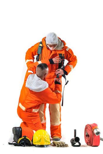 Man working on orange against white background