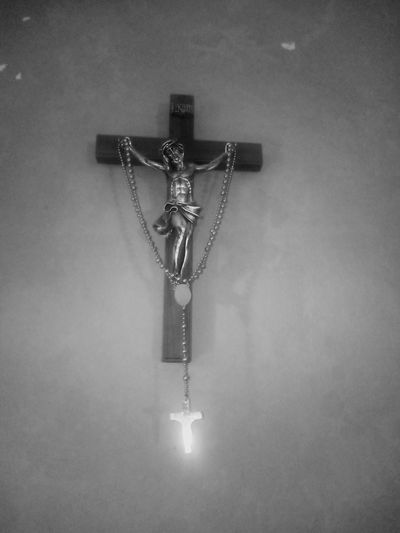Close-up of cross against white background