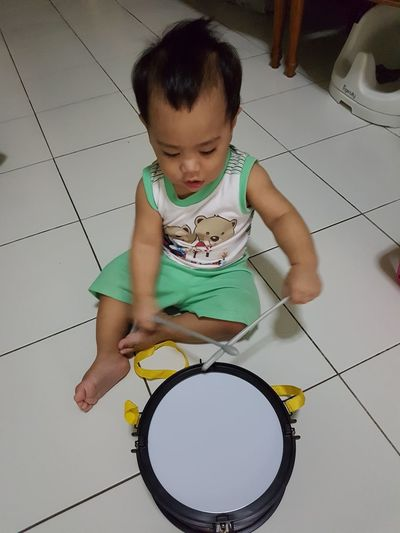 Young drummer. Child Childhood Full Length Sitting Playing Learning Fun Casual Clothing