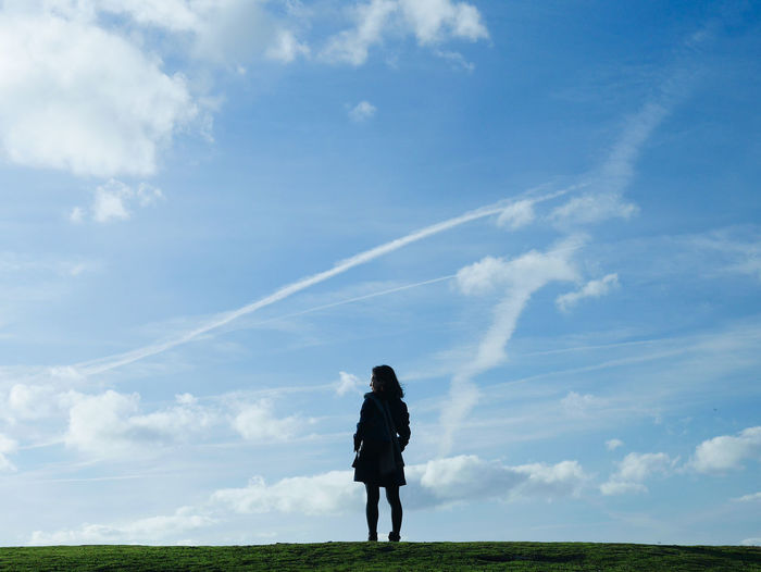 Beauty In Nature Blue Casual Clothing Cloud Cloud - Sky Cloudy Day Field Freedom Full Length Grass Grassy Horizon Over Land Idyllic Landscape Leisure Activity Lifestyles Nature Outdoors Scenics Sky Solitude Standing Tranquil Scene Tranquility