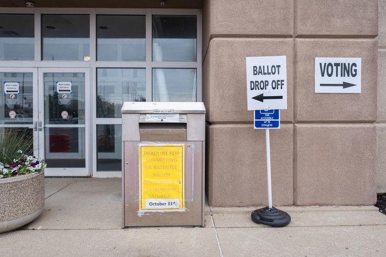 Information sign on entrance of building