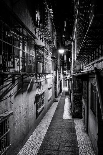 Monochrome Streetphotography Macau Street Photography Built Structure Architecture The Way Forward Direction Transportation Illuminated Night Building Exterior Diminishing Perspective Building No People Footpath Nature Connection Lighting Equipment City Ceiling Outdoors Bridge Empty