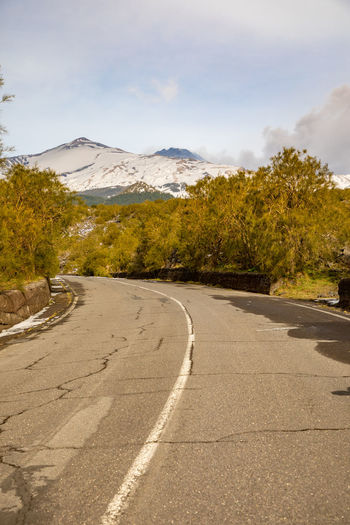 Etna Volcano Sicilia Italy Sicily Winter Snow Road Tree Sky Plant The Way Forward Direction Mountain Transportation Beauty In Nature Tranquil Scene Tranquility Scenics - Nature Cloud - Sky Nature Day No People Non-urban Scene Symbol Landscape Mountain Range Outdoors Diminishing Perspective Long