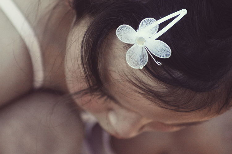 Close-Up Of Girl Wearing Hair Clip