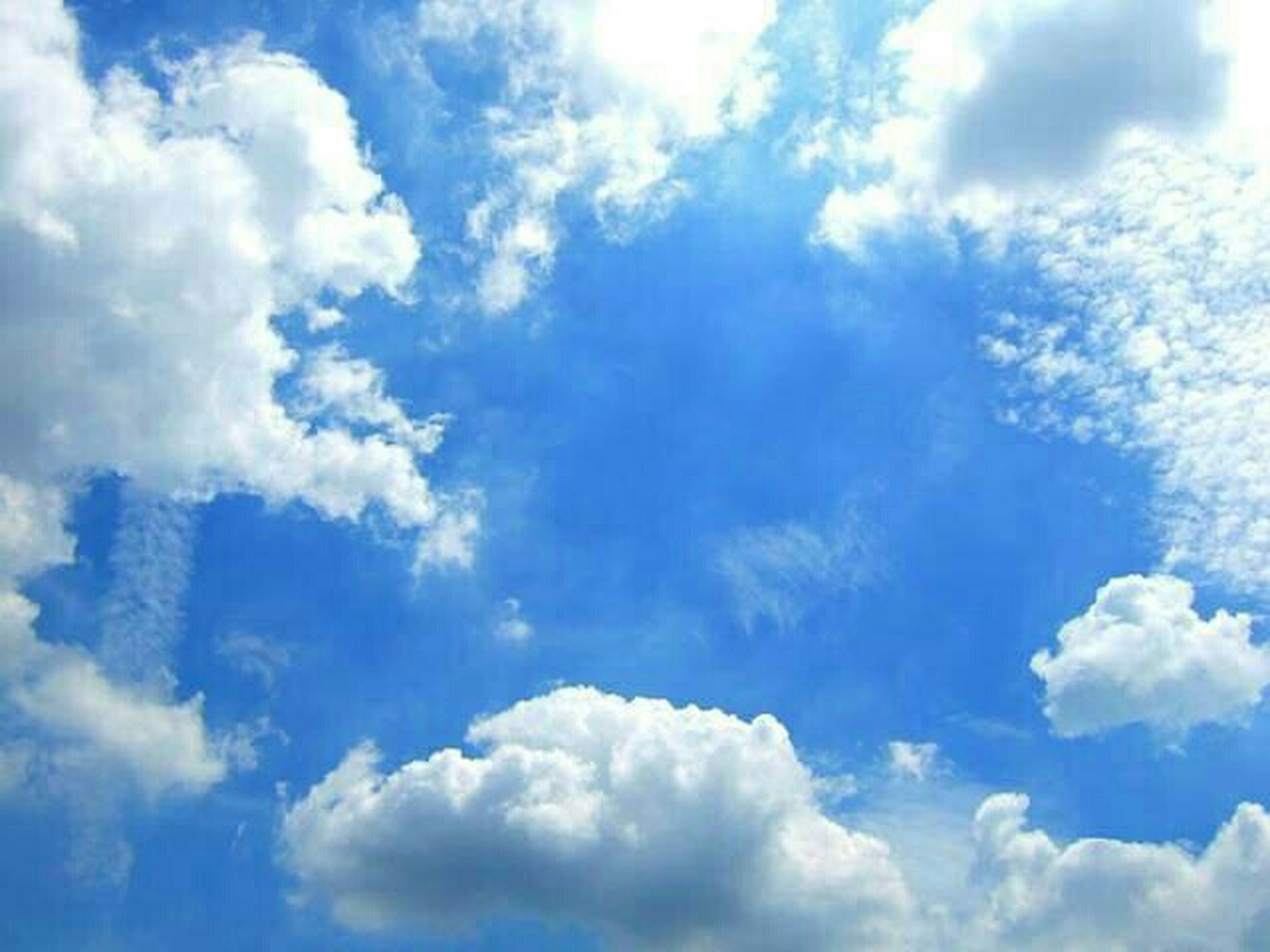 sky, low angle view, sky only, cloud - sky, blue, beauty in nature, tranquility, scenics, nature, backgrounds, cloudscape, cloudy, tranquil scene, white color, cloud, full frame, fluffy, idyllic, day, softness