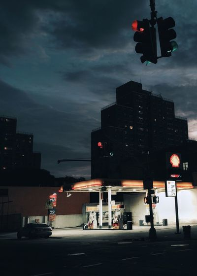 Petrol Station Gas Station Transportation Mode Of Transportation Sky City Motor Vehicle Building Exterior Architecture Street Car Stoplight Illuminated Cloud - Sky Sign Built Structure