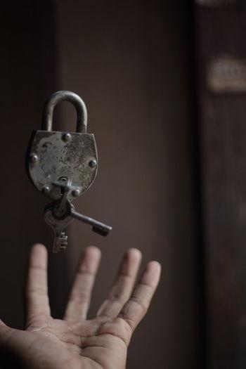 Cropped hand catching padlock