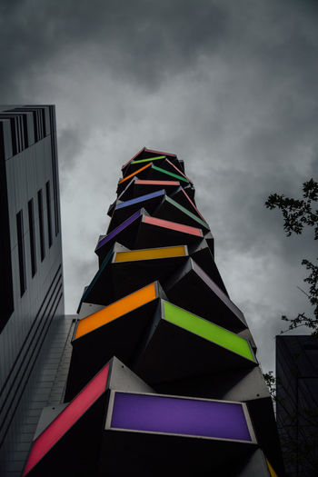 A colourful art statue in the City of London, United Kingdom. Architecture Art ArtWork Built Structure City Cloud Cloud - Sky Cloudy Colorful London Low Angle View Modern Multi Colored No People Outdoors