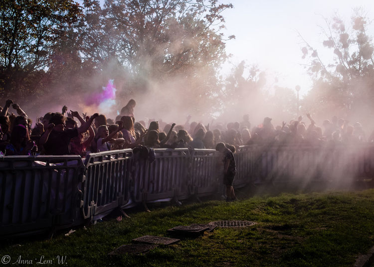 Holi festival Poznań. Group Of People Large Group Of People Leisure Activity Crowd Real People Men Smoke - Physical Structure Tree Enjoyment Women Nature Plant Adult Day Celebration Fog Lifestyles Outdoors Standing Arms Raised The Week on EyeEm EyeEm Best Shots EyeEm Masterclass
