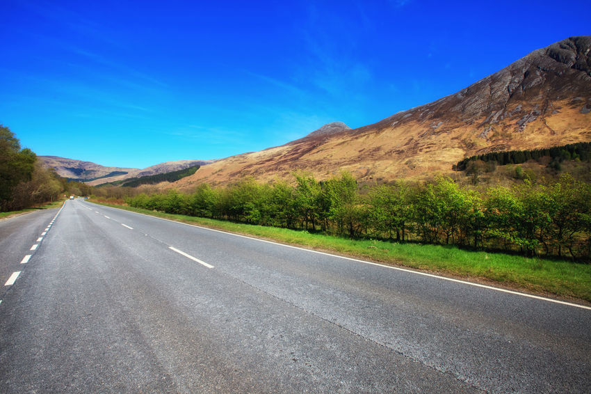 Endless road at Glencoe Area, Scottish Highlands, Scotland, UK Arid Climate Asphalt Blue Day Endless Road Glencoe Glencoe Scotland Highway Landscape Mountain Mountain Range Mountains Nature No People Outdoors Road Road Road Trip Scenics Scotland Scottish Highlands Sky The Way Forward Travel Uk