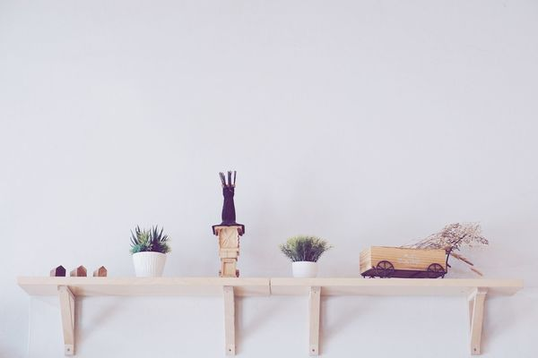 Toys decoration in coffee shop Wooden Cart Coffee Shop Copy Space Decoration Dry Grass Grass Interior Plant Shelves Table Toys Vase White Background Wood