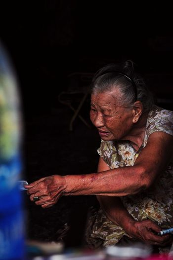 The old lady (1/4) Vietnam People One Person Adult Indoors  Real People Women Lifestyles Front View Casual Clothing Sitting Portrait Three Quarter Length Looking Females Mature Adult Senior Adult Senior Women Hairstyle The Street Photographer - 2018 EyeEm Awards