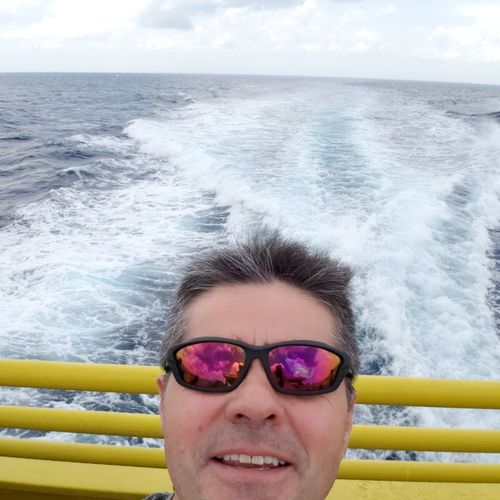 Portrait of man wearing sunglasses on boat sailing in sea