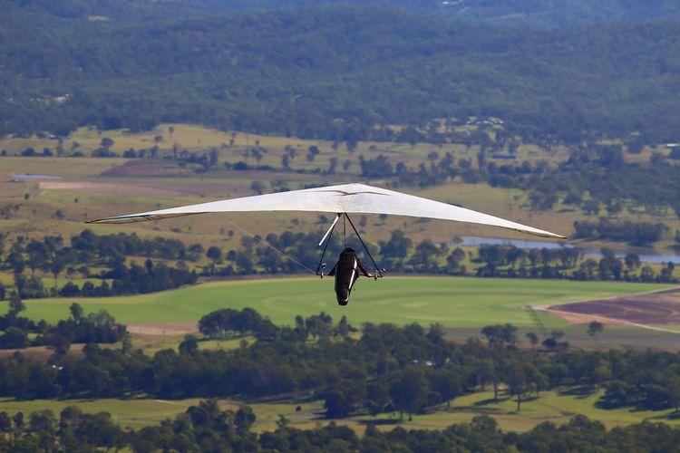 Hang glider taking off from tamborine mountain, queensland, australia.