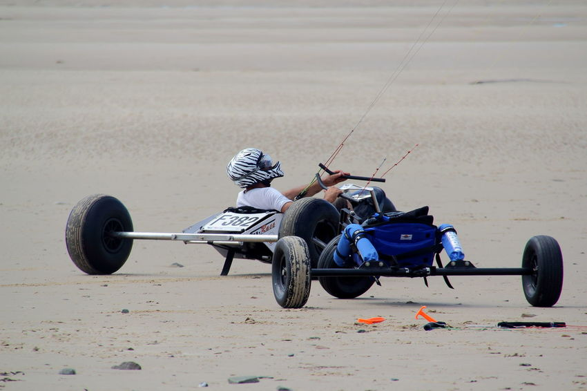 Beach Crash Helmet Day Focus On Foreground Full Length Land Land Vehicle Leisure Activity Lifestyles Men Mode Of Transportation Motion Motor Vehicle Nature One Person Outdoors Real People Sand Sport Be Brave