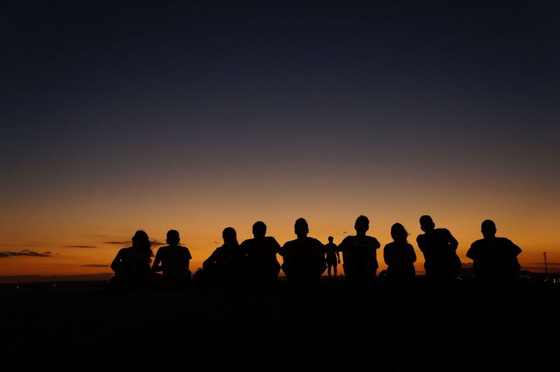 Silhouette Of People Against Clear Sky