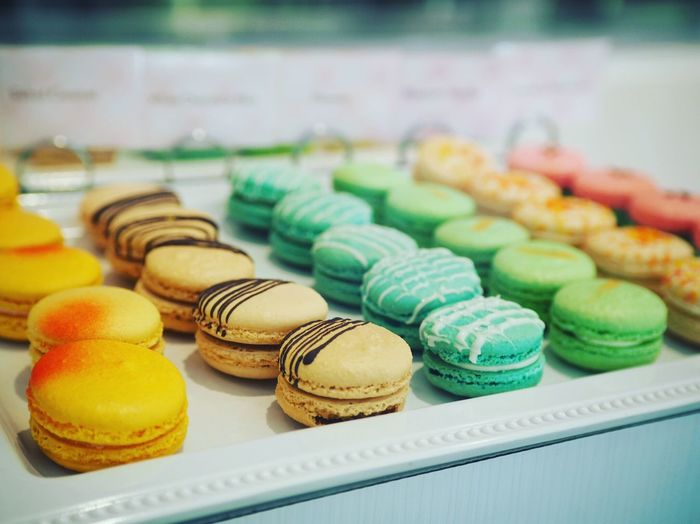 Close-up of colorful macaroons on tray