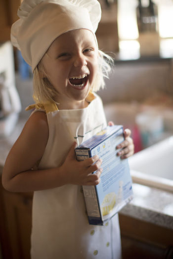 Happy girl holding hat