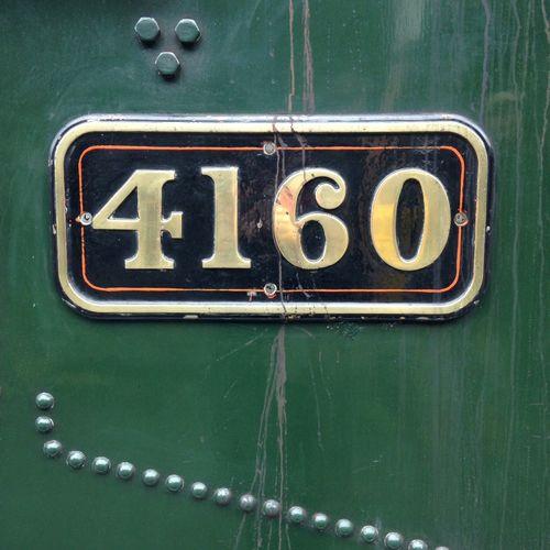 Number on green metallic steam engine train