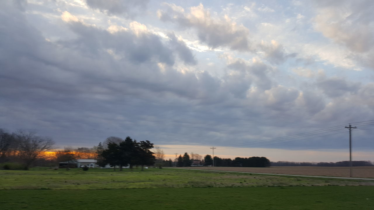 cloud - sky, sky, tree, nature, field, grass, no people, scenics, tranquil scene, outdoors, beauty in nature, tranquility, day, built structure, landscape, architecture, electricity pylon, building exterior