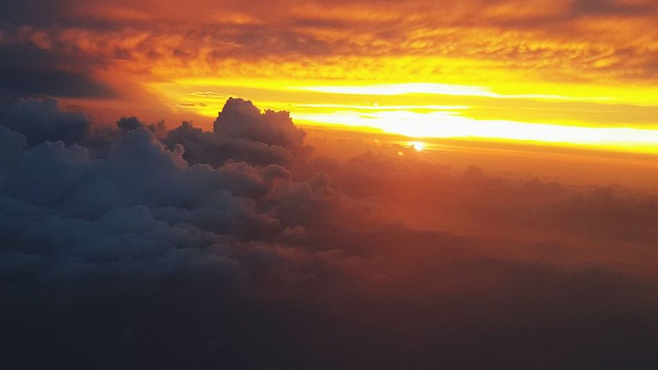Sunset Cloud - Sky Nature Morning Mountain Outdoors Fog Beauty In Nature Sky Scenics Sun Ethereal Travel No People Awe Vacations Landscape Plane Shots Cloud Formations Clouds And Sky Tranquility Spirituality Nature Travel Destinations Beauty