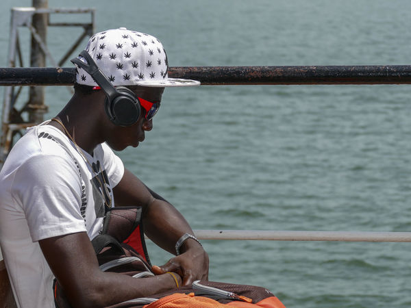 River Crossing Barra Banjul Ferry Banjul Cap Casual Clothing Close-up Day Gambia  Ganja Holding Leisure Activity Lifestyles Marijuana Nature Nautical Vessel Occupation One Person Outdoors Real People River River Crossing Sea Sitting Technology Water Young Adult