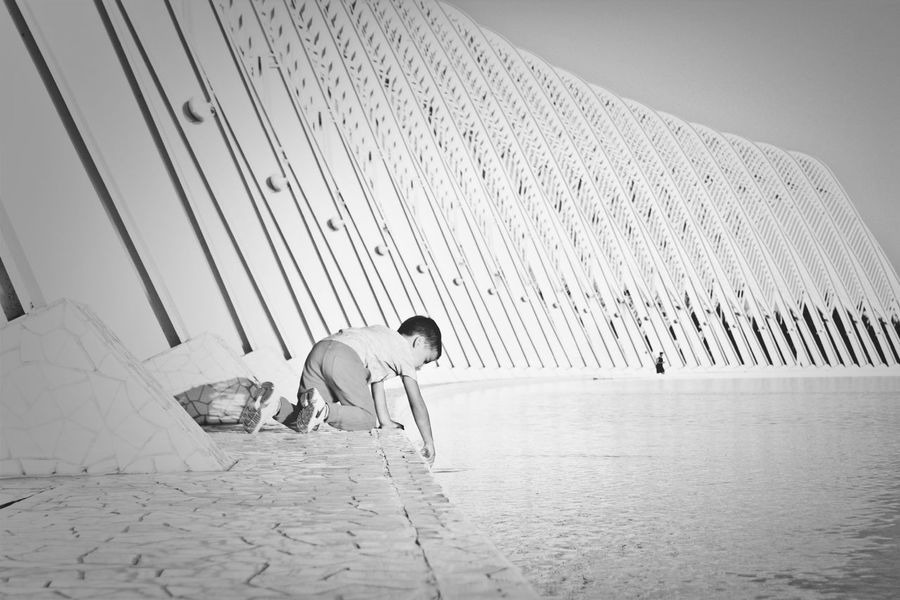 Kid Playing Oaka Black And White