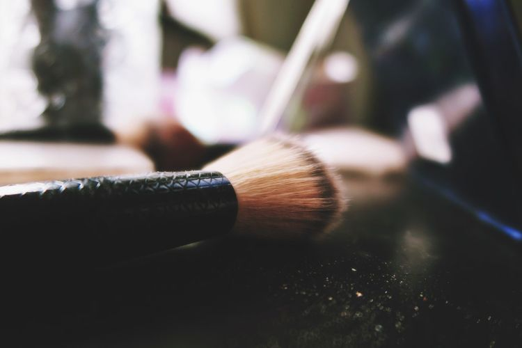 Close-up of make-up brush on table