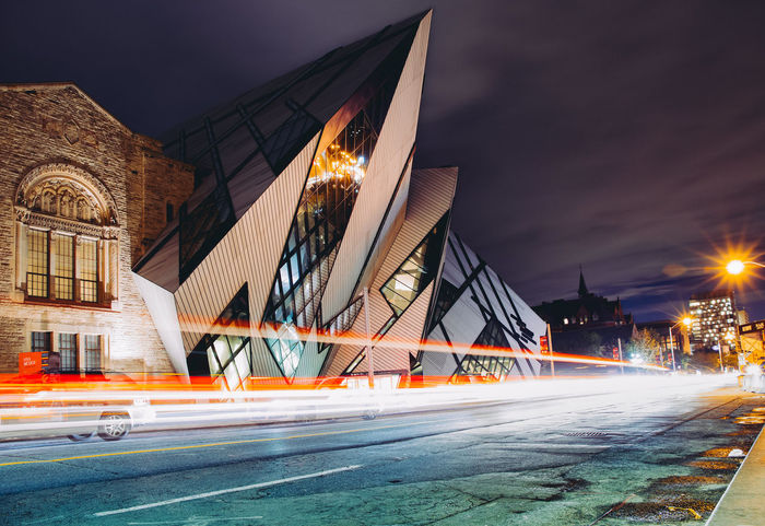 Architecture Building Built Structure Canada City City Life Cityscape Engineering Exterior Illuminated Light Trail Motion Night Ontario Outdoors Road Royal Ontario Museum Sky Street Toronto Travel Destinations Urban Eyeemphoto Mobility In Mega Cities