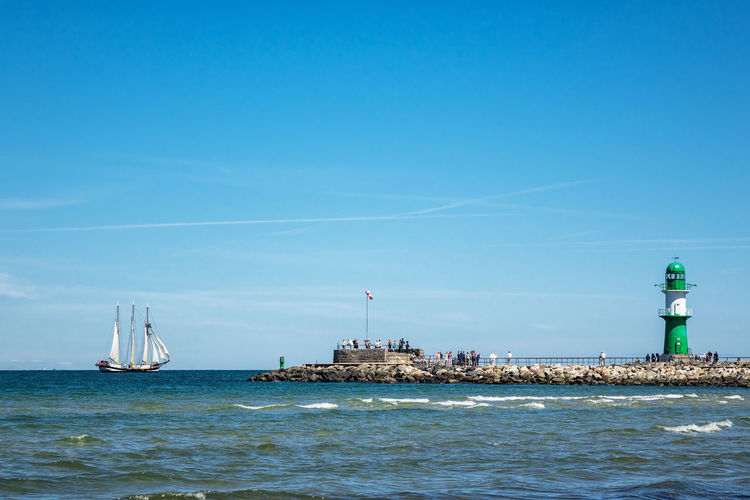Windjammer on the Baltic Sea. Architecture Baltic Sea Beauty In Nature Blue Day Horizon Over Water Lighthouse Mole Nature Nautical Vessel No People Outdoors Rostock Sailboat Sailing Sailing Ship Sea Sky Transportation Warnemünde Water Windjammer