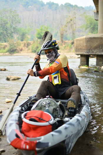 Water Outdoors Chiang Rai, Thailand Transportation One Person Mode Of Transportation Helmet Real People Day Nautical Vessel Sitting River Adventure Nature Safety Lifestyles Leisure Activity Sport Men Clothing Riding