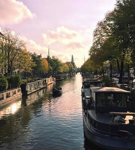 Sunset canals in Amsterdam Tree Reflection Water River Nautical Vessel Sky City No People Outdoors Day Boat Boats Sunset Autumn Amsterdam Canal