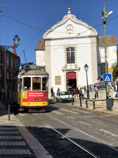 Street tram in Lisbon, Portugal Lisbon Portugal Transportation Mode Of Transportation Public Transportation Track Sky Railroad Track Rail Transportation Day Cable Car Land Vehicle Nature City Architecture Building Exterior Built Structure Street Group Of People Real People Building Cable Outdoors