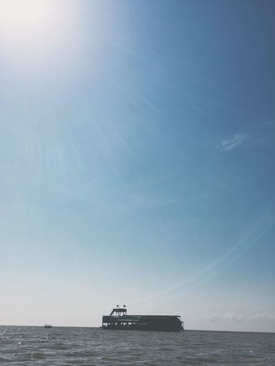 Ship Sailing On Sea Against Sky