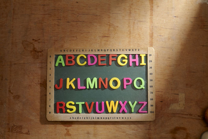 alphabet a to z on the blackboard Alphabet Education Blackboard  Chalkboard Directly Above A To Z English Colorful Text Western Script Table Indoors  Communication Wood - Material Multi Colored Capital Letter No People Message Close-up Toy Block Wood Toy Letter Flooring Still Life