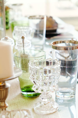 Detail image of Elegant dining table setting Dining Room Elegant Bowl Close-up Day Dining Dining Area Dining Table Dining Tables And Chairs Diningroom Drinking Glass Food And Drink Freshness Indoors  Luxury No People Place Setting Plate Table Tablecloth Wineglass