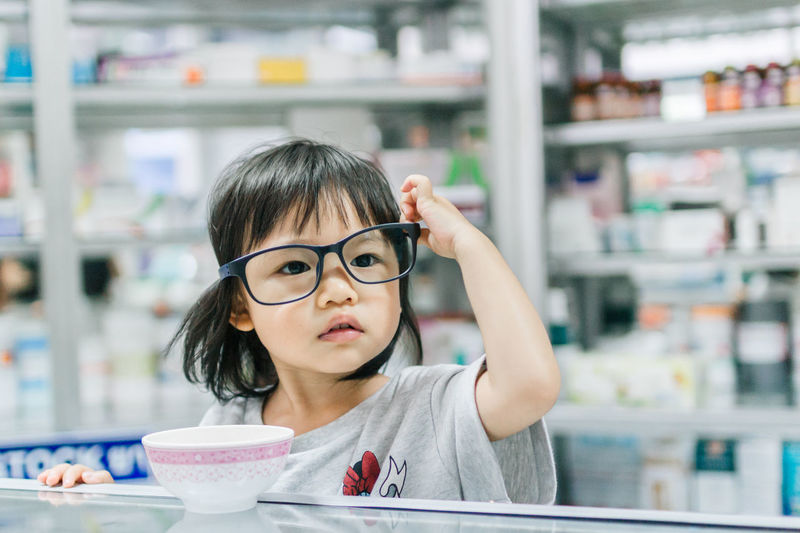 Asian Girl Bowl Childhood Close-up Day Drink Drinking Glass Eating Eyeglasses  Focus On Foreground Food Food And Drink Freshness Girls Headshot Ice Cream Indoors  One Person Real People Sweet Food