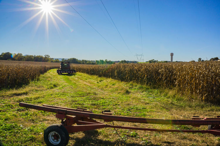 Agricultural Machinery Agriculture Beauty In Nature Combine Harvester Day Farm Field Green Color Growth Landscape Nature No People Outdoors Rural Scene Scenics Sky Sunbeam Sunlight Technology Tractor Transportation