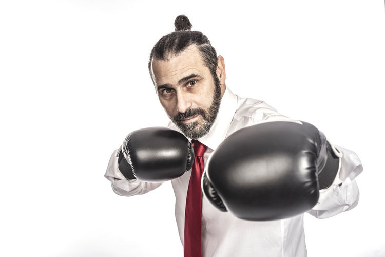 Studio Shot Boxing - Sport Boxing Glove Sport Indoors  Businessman Angry Man Fighting Fighter Motivation Aggressive Competition Competitive Long Hair Portrait Confident  Defence