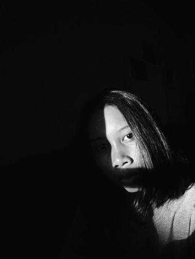 Portrait of young woman in darkroom