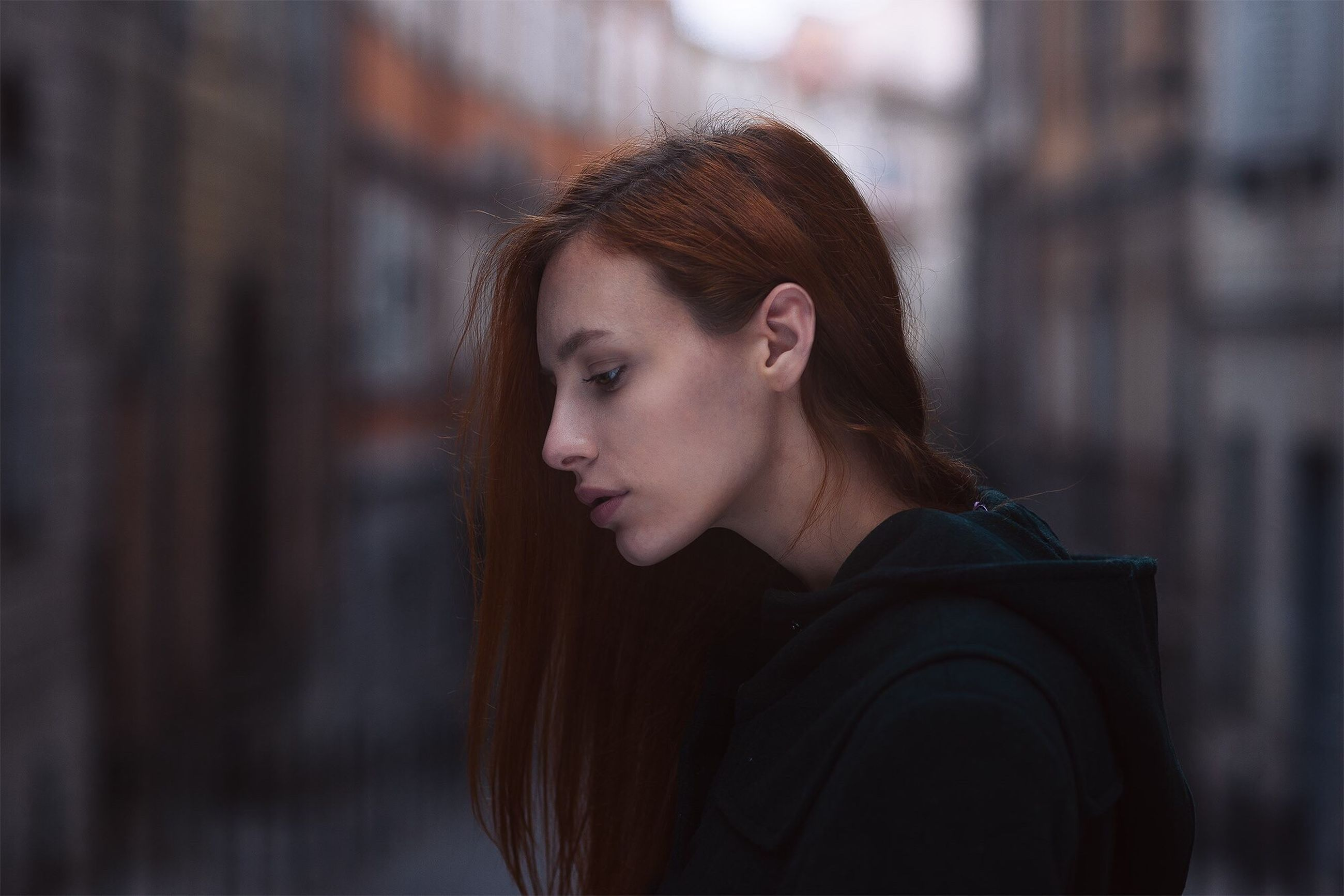 young adult, focus on foreground, lifestyles, headshot, person, front view, young women, leisure activity, close-up, portrait, looking at camera, head and shoulders, contemplation, human face, long hair, casual clothing