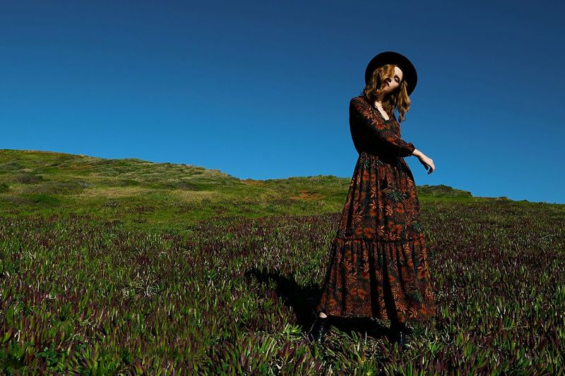 Woman on field against clear sky