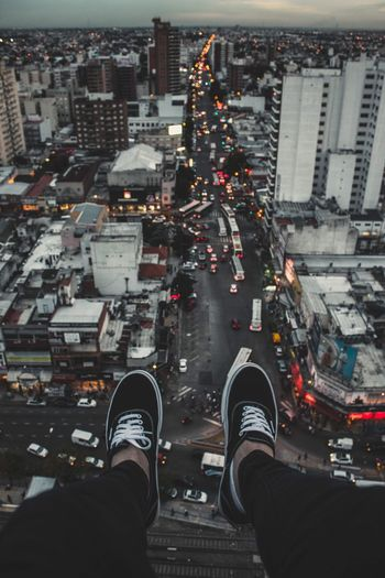 ROOFTOP Shoe High Angle View Personal Perspective Low Section City Human Body Part Standing Street Real People Human Leg One Person Building Exterior Road Cityscape City Life Architecture Built Structure Men Outdoors Day
