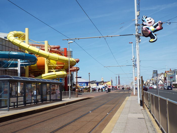 Blue Sky Tourism The Essence Of Summer Summertime Summer 2016 People Tourists The Street Photographer - 2016 EyeEm Awards People Walking  People Around You Blackpool Promenade Tourist Attraction  Blackpool Sandcastle Waterpark Sandcastle Waterpark Slides Water Slides Yellow Water Slide Red Water Slide